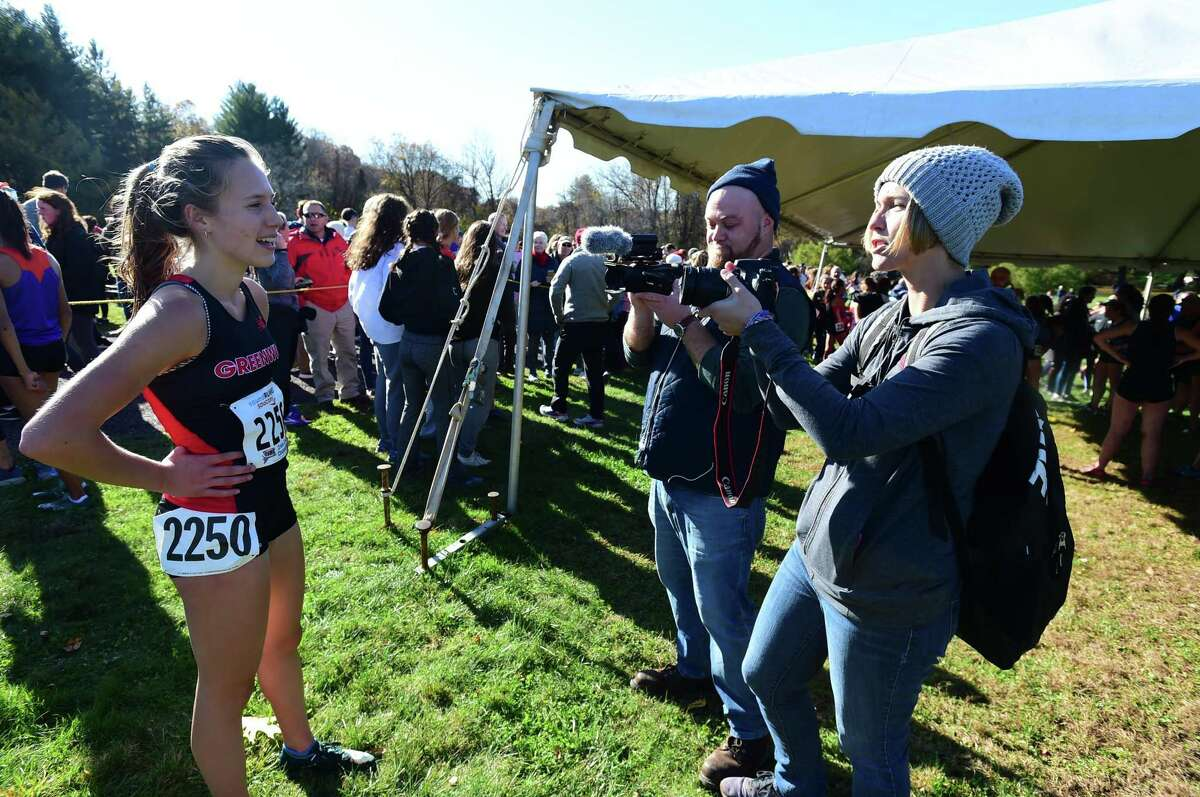 State Open champ Mari Noble of Greenwich is interviewed after the race on Friday.