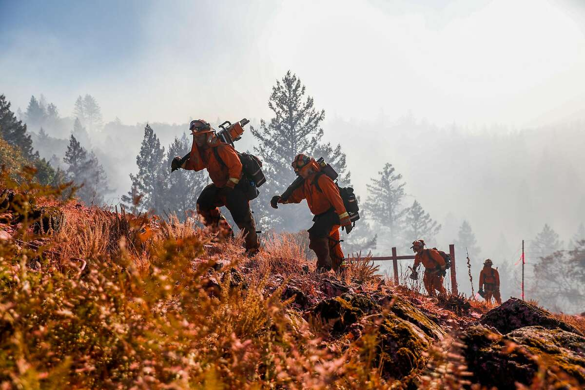 Inmate firefighters battle Kincade Fire which was burning near Ida Clayton Road in Calistoga, California, on Tuesday, Oct. 29, 2019.