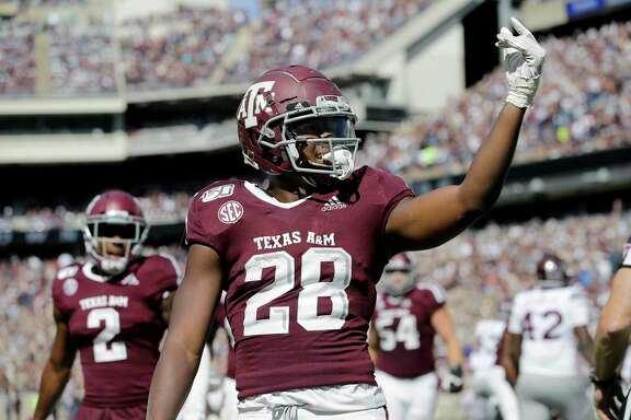 Texas A&M running back Isaiah Spiller (28) reacts after scoring a touchdown against Mississippi State during the second half of an NCAA college football game, Saturday, Oct. 26, 2019, in College Station, Texas.