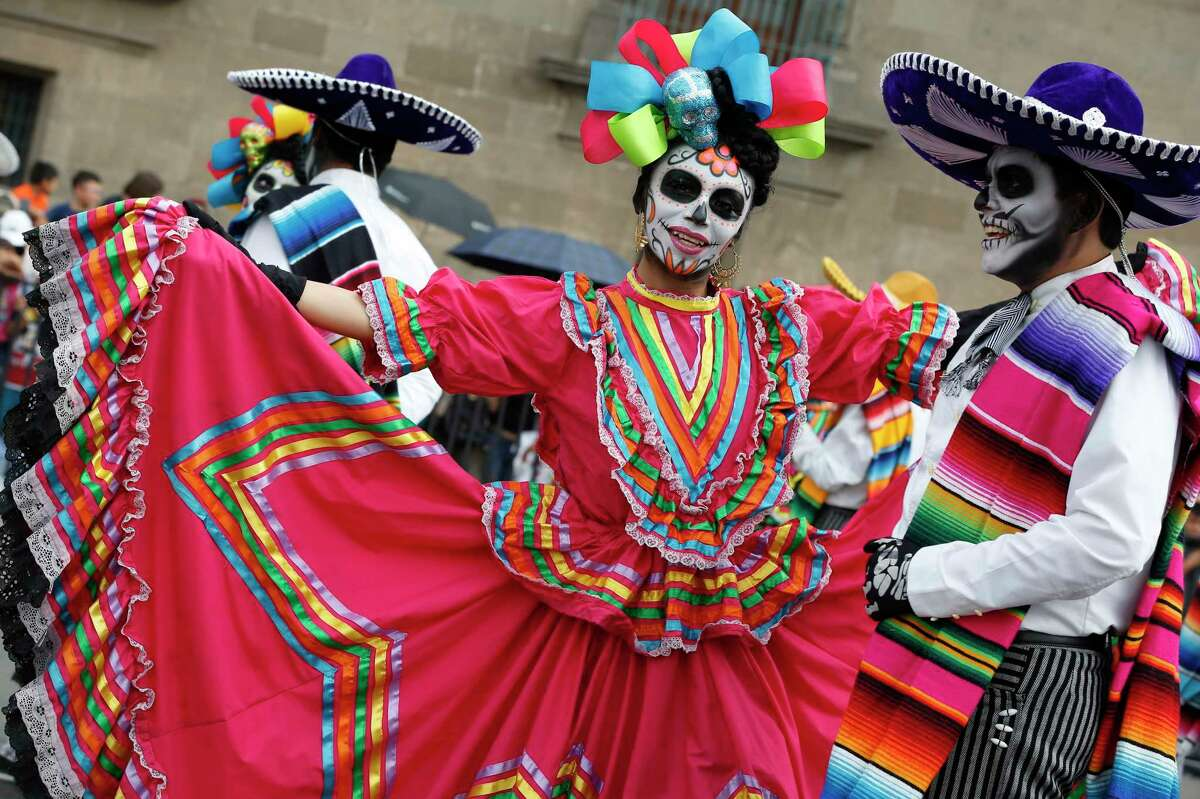 Performers in costume attend a Day of the Dead parade in Mexico City, Sunday, Oct. 27, 2019. (AP Photo/Ginnette Riquelme)