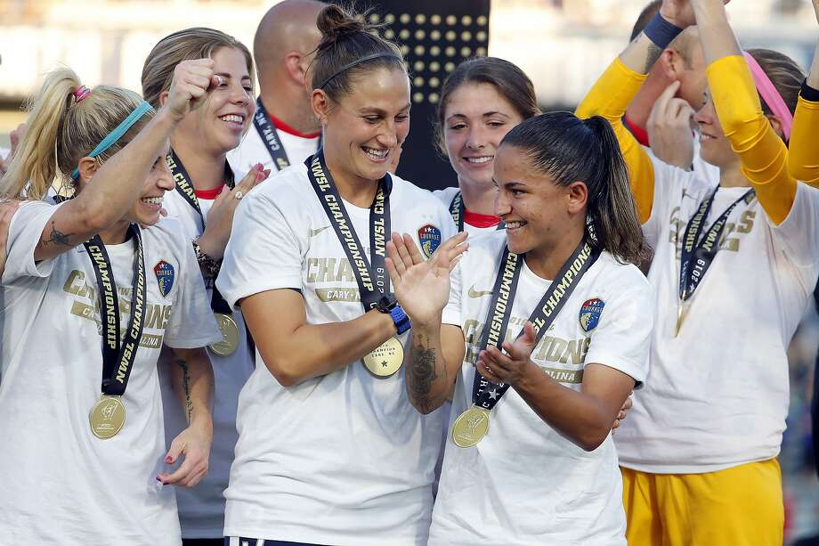 Members of the North Carolina Courage celebrate the NWSL championship last Sunday afetr beating the Chicago Red Stars 4-0. The NWSL saw increased attendance in 2019. Photo: Karl B DeBlaker / Associated Press