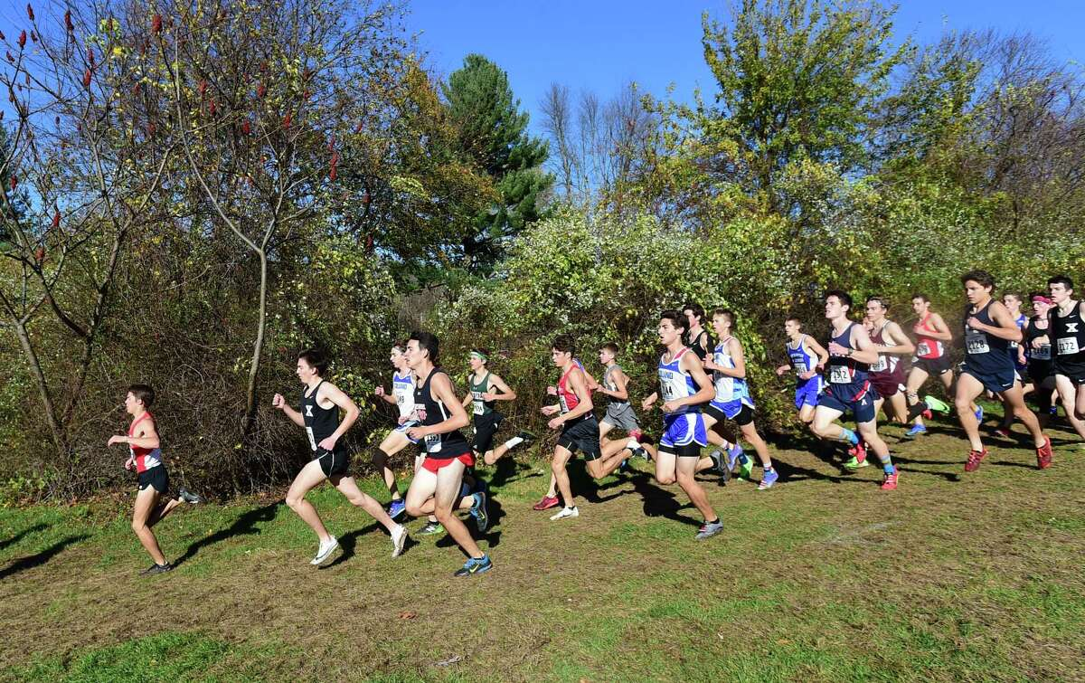 Manchester, Connecticut -Wednesday, November 1, 2019: 1st place finisher Gavin Sherry of Conard H.S., left, and second place finisher Robbie Cozean of Xavier H.S, second from left, during the CIAC Boys Cross Country Open Championship Friday at Wickham Park in Manchester.