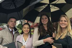 Meet the Gen Y and millennial generation of Jehovah's Witnesses. (From left) Lucas Quinones, Jr. and his wife, Janai, with sisters Tiffani and Makayla Wells work full time professional jobs in addition to volunteering to go door to door in Troy and Albany evangelizing. They carry iPads loaded with Bible verses rather than Bibles. They practice their pitches to ensure they are a succinct 1 minute and 20 seconds, no longer.