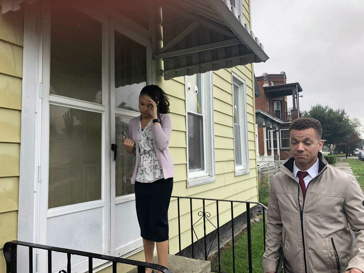 Jehovah's Witnesses do their volunteer door knocking on rainy, blustery days. One cold autumn day in Troy, the Quinones' door often went unanswered. But when they got to a house where a grandfather was babysitting toddlers, he was delighted to chat with grown ups.