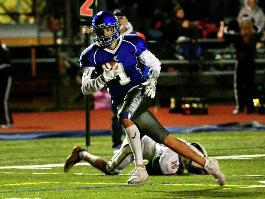 Fairfield Ludlowe's Carlos Moreno (1) heads to the end zone to score a touchdown against Trumbull during football action in Fairfield, Conn., on Friday Nov. 1, 2019. Photo: Christian Abraham / Hearst Connecticut Media / Connecticut Post