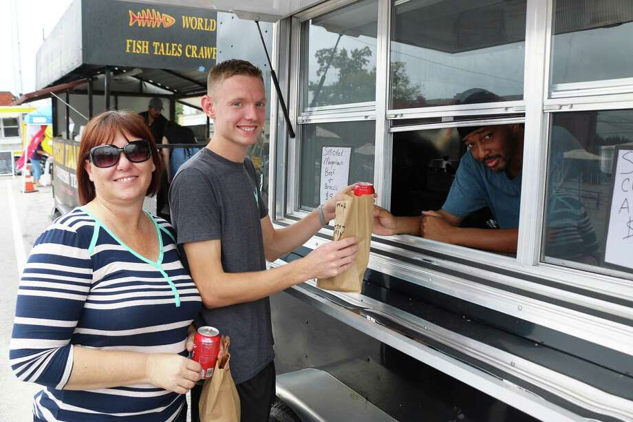 Curtis Jones of After The Game Food trailer was a regular to Food Truck Friday during the early days of the event. Tami Green and her son Austin gave thumbs up for the food. Photo: David Taylor / Staff Photo