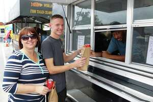 Curtis Jones of After The Game Food trailer was a regular to Food Truck Friday during the early days of the event. Tami Green and her son Austin gave thumbs up for the food.