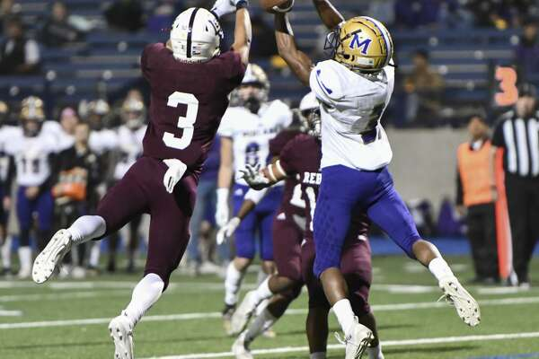 Midland High's Preston Brockington (3) attempts to catch the ball as Lee's Karl Taylor (3) attempts an interception Friday, Nov. 1, 2019 at Grande Communications Field.