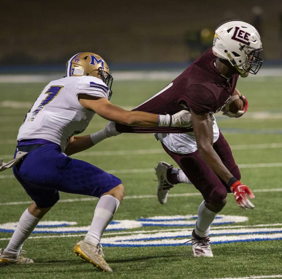 Lee's Loic Fouonji is tackled by Midland High's Edgar Baeza (7) on Friday, Nov. 1, 2019 at Grande Communications Field. Photo: Jacy Lewis/Reporter-Telegram