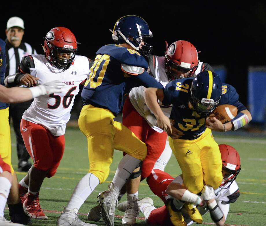 East Haven's Eric Araujo, right, tries to break free from a Cheshire defender on Friday night. Photo: Dave Phillips / For Hearst Connecticut Media