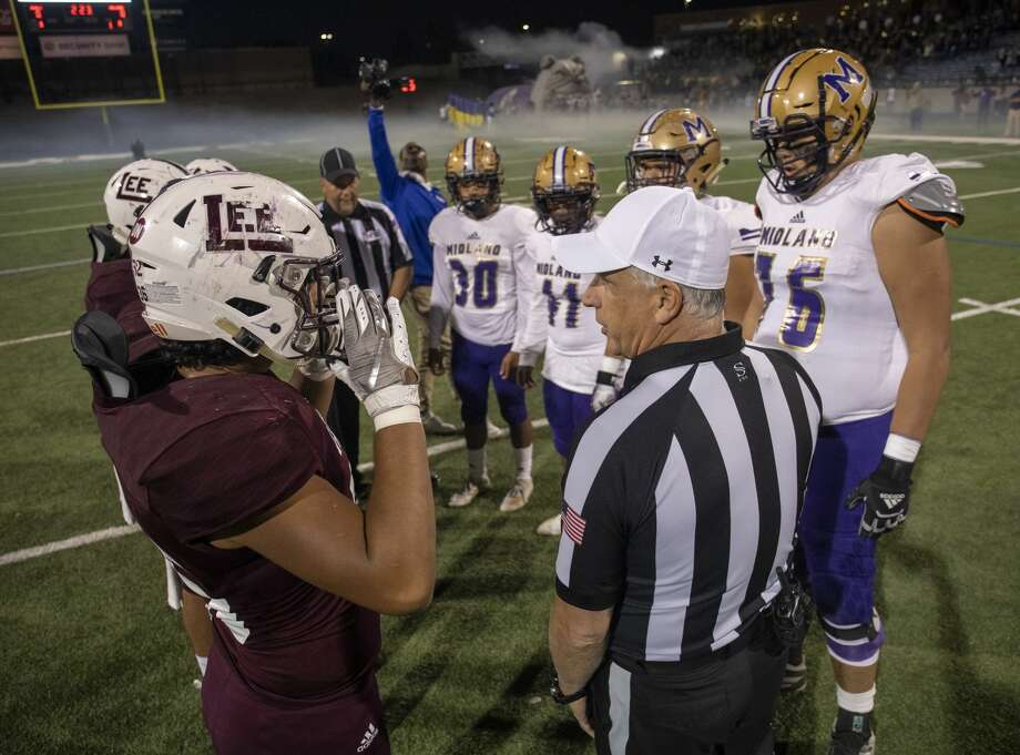 Lee and Midland High meet at the 50 yard line to flip a coin Friday, Nov. 1, 2019 at Grande Communications Field. Photo: Jacy Lewis/Reporter-Telegram