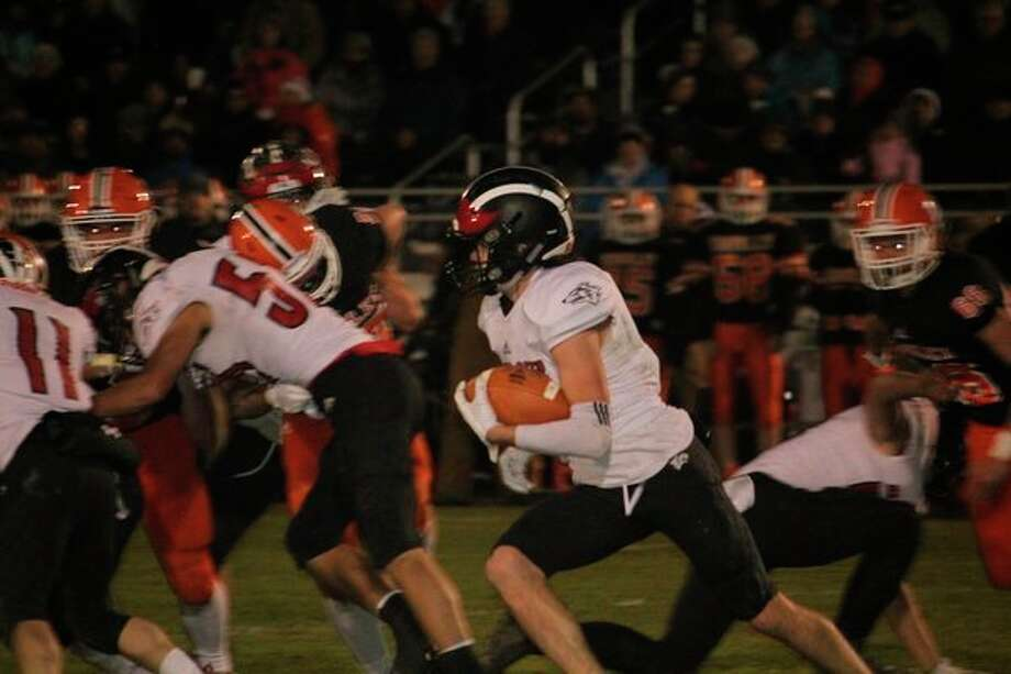 Reed City's Landen Tomaski looks for running room against Kingsley in Friday's playoff game. (Pioneer photo/John Raffel)