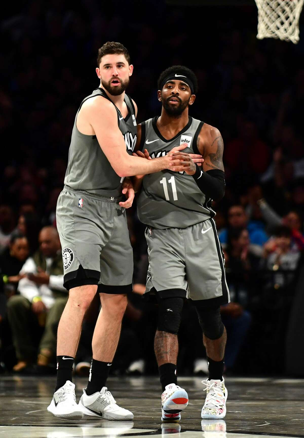 NEW YORK, NEW YORK - NOVEMBER 01: Joe Harris #12 high fives Kyrie Irving #11 of the Brooklyn Nets after a three pointer during the second half of their game against the Houston Rockets at Barclays Center on November 01, 2019 in the Brooklyn borough New York City. NOTE TO USER: User expressly acknowledges and agrees that, by downloading and or using this Photograph, user is consenting to the terms and conditions of the Getty Images License Agreement. (Photo by Emilee Chinn/Getty Images)