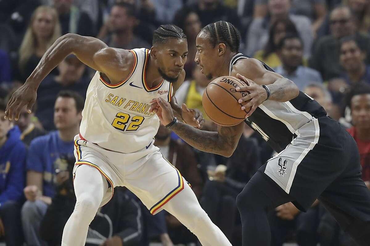 San Antonio Spurs guard DeMar DeRozan, right, drives against Golden State Warriors forward Glenn Robinson III (22) during the first half of an NBA basketball game in San Francisco, Friday, Nov. 1, 2019. (AP Photo/Jeff Chiu)
