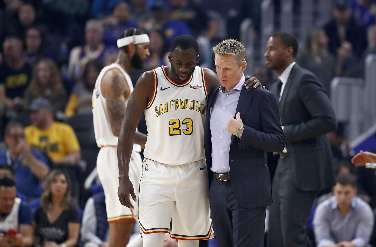 Draymond Green #23 of the Golden State Warriors talks to head coach Steve Kerr during their game against the San Antonio Spurs at Chase Center on November 01, 2019 in San Francisco, California.