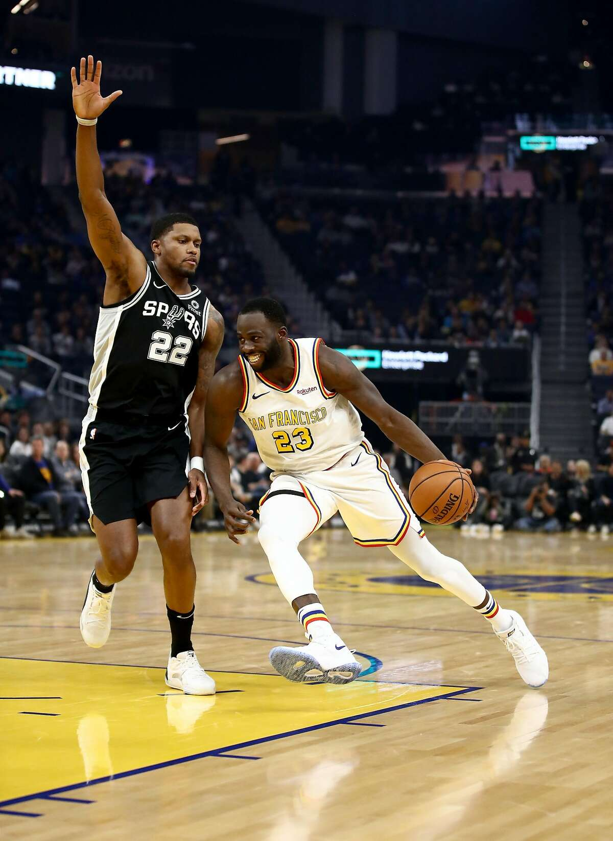 Draymond Green #23 of the Golden State Warriors drives on Rudy Gay #22 of the San Antonio Spurs at Chase Center on November 01, 2019 in San Francisco, California.