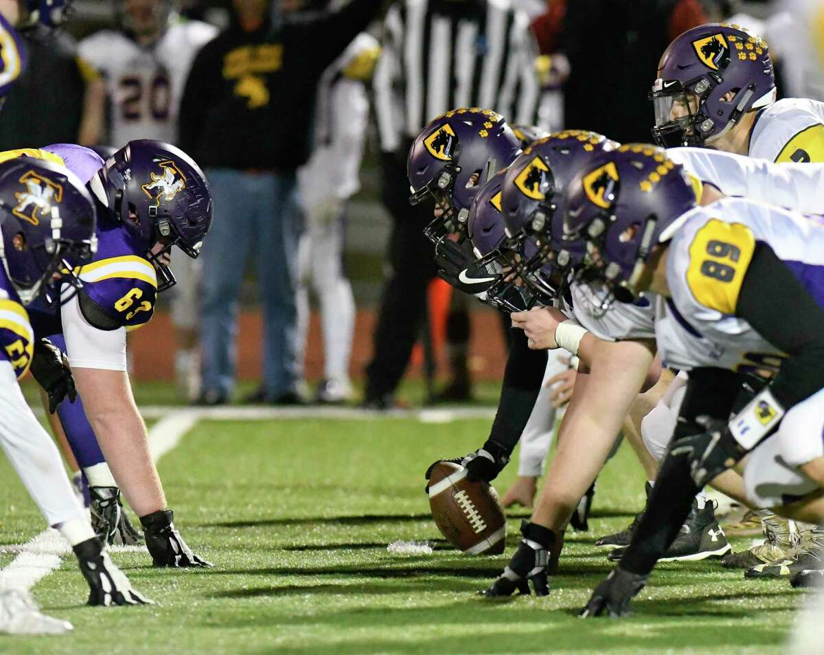 Ballston Spa's offensive line ,right, lines up against Troy's defensive line during a Section II Class A semifinal high school football game in Troy, N.Y., Friday, Nov. 1, 2019. (Hans Pennink / Special to the Times Union)