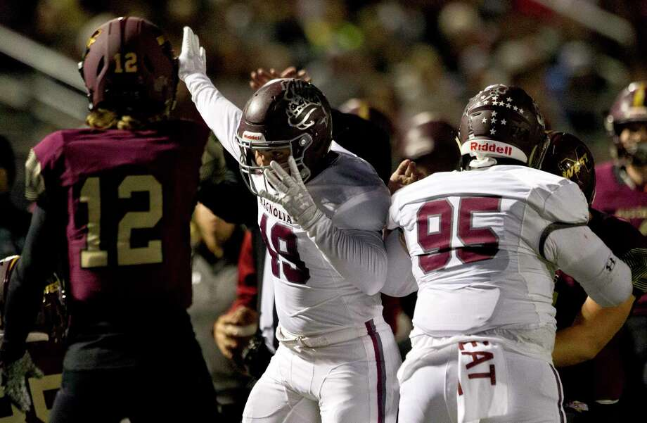 Magnolia linebacker Rylan Ritch (49) signals after defensive back Nathan Hakes forced a fumble by Magnolia West wide receiver Trey Leggett during the second quarter of a District 8-5A high school football game at Magnolia West High School, Friday, Nov. 1, 2019, in Magnolia. Photo: Jason Fochtman, Houston Chronicle / Staff Photographer / Houston Chronicle