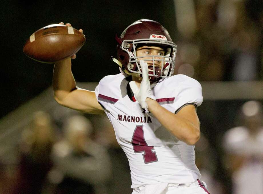 In this file photo, Magnolia quarterback Travis Moore (4) throws a pass during the first quarter of a District 8-5A high school football game at Magnolia West High School, Friday, Nov. 1, 2019, in Magnolia. Photo: Jason Fochtman, Houston Chronicle / Staff Photographer / Houston Chronicle