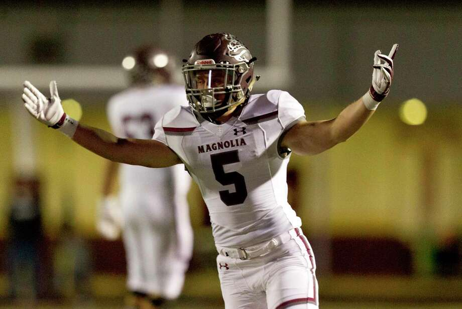 In this file photo, Magnolia running back Mitch Hall (5) reacts after tight end Ben Coligan caught a 62-yard touchdown pass from quarterback Travis Moore during the first quarter of a District 8-5A high school football game at Magnolia West High School, Friday, Nov. 1, 2019, in Magnolia. Photo: Jason Fochtman, Houston Chronicle / Staff Photographer / Houston Chronicle