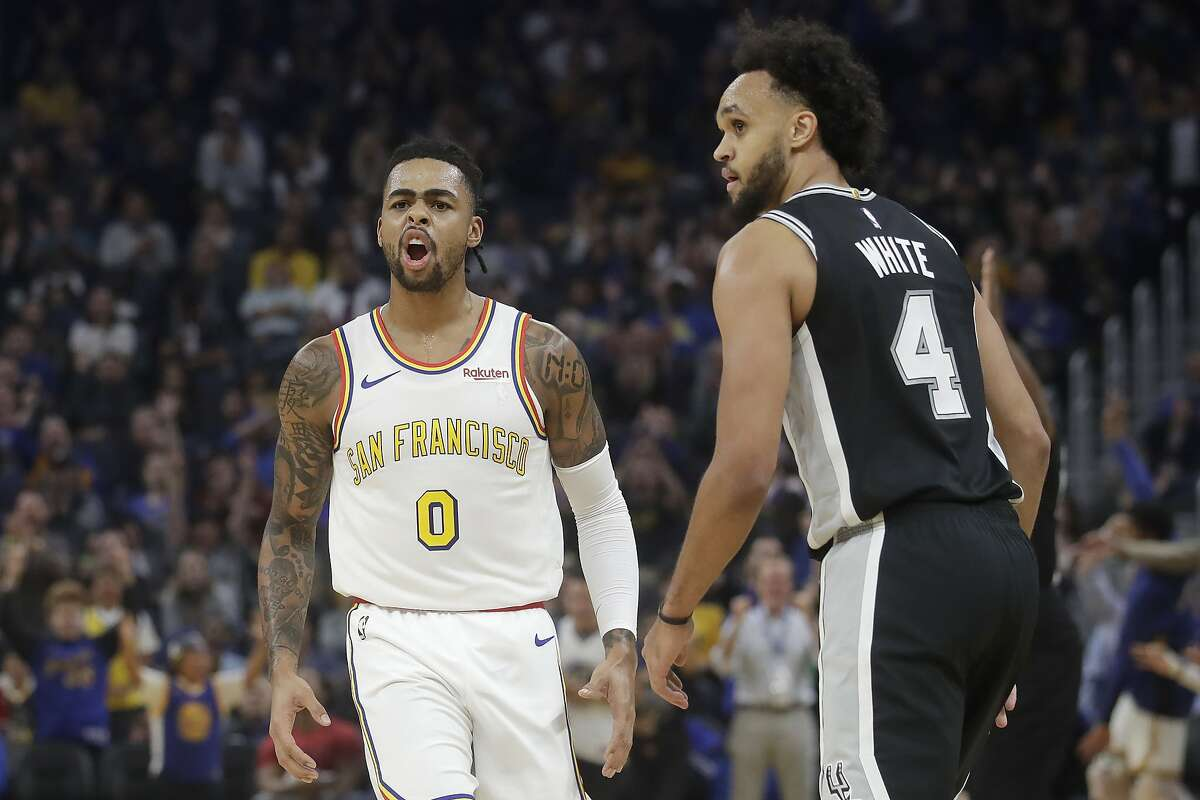 Golden State Warriors guard D'Angelo Russell (0) reacts next to San Antonio Spurs guard Derrick White (4) after scoring during the first half of an NBA basketball game in San Francisco, Friday, Nov. 1, 2019. (AP Photo/Jeff Chiu)