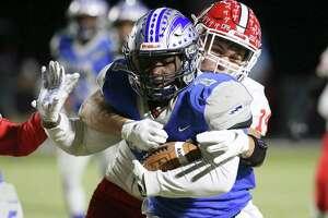 Randolph's Jaden Arthur (01) battles for yardage against Jourdanton's Evan Lambert (14) during their football game at Randolph on Friday, Nov. 1, 2019. (Kin Man Hui/San Antonio Express-News)