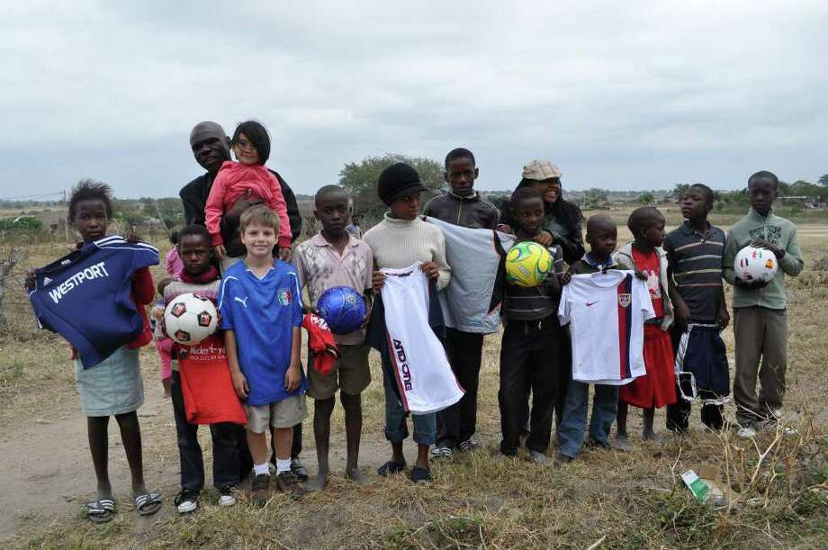 Rob Diorio, a third grader at Kings Highway Elementary, traveled to the Welverdiend Village in South Africa to deliver soccer and school supplies. Photo: Contributed Photo / Westport News