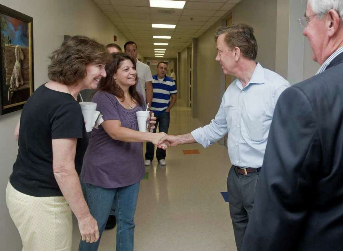 Ned Lamont meets CARTUS employees in a hall at Danbury's second-largest employer. Lamont toured CARTUS on 40 Apple Ridge Road. Monday, Aug. 9, 2010