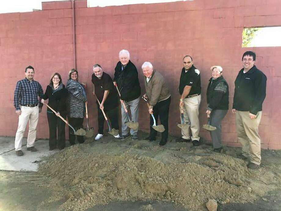 Pictured are Rick Booms of Booms Construction with hospital board and senior staff members Jill Wehner, Deb Geiger, Dave Hunter, Pat McCollough board chairman, Paul Clabuesch, hospital CEO, Eli Kabban, Janet Sloan, and Gary Booms of Booms Construction. (Submitted Photo)