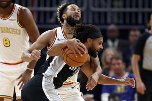 SAN FRANCISCO, CALIFORNIA - NOVEMBER 01:  Patty Mills #8 of the San Antonio Spurs is guarded by Ky Bowman #12 of the Golden State Warriors at Chase Center on November 01, 2019 in San Francisco, California.  NOTE TO USER: User expressly acknowledges and agrees that, by downloading and or using this photograph, User is consenting to the terms and conditions of the Getty Images License Agreement. (Photo by Ezra Shaw/Getty Images)