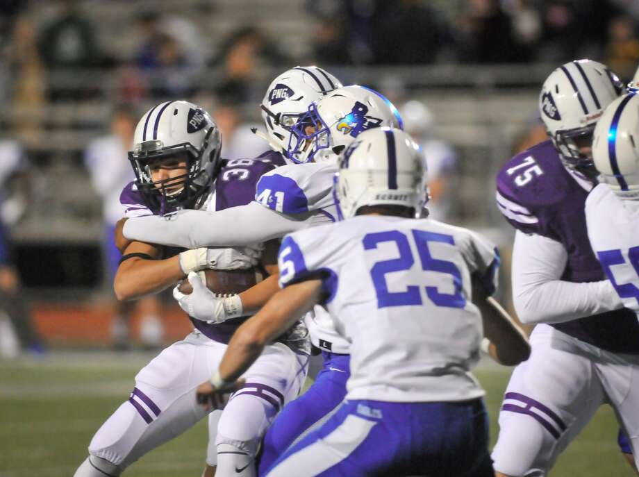 Port Neches-Groves running back Koby Tran is met by a swarm of Barbers Hill defenders as he heads toward the sideline during Friday's game at Indian Stadium in Port Neches. Photo: Mike Tobias/ Special To The Enterprise