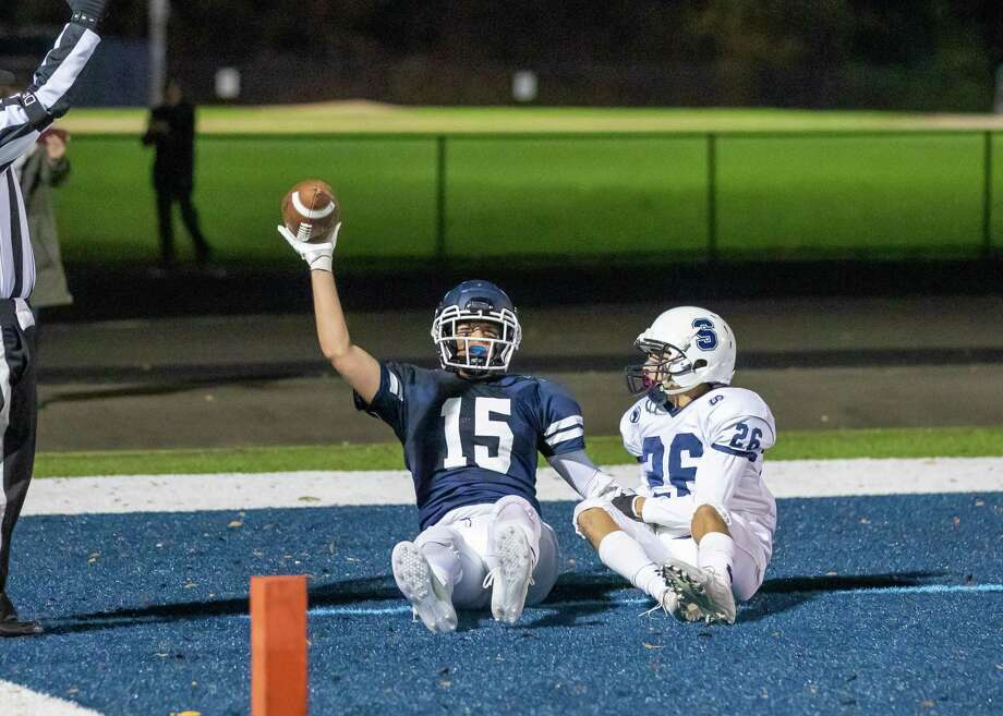 Kyle Hyzy celebrates his touchdown catch in Wilton's 35-24 win over Staples on Friday night. Photo: Gretchen McMahon / For Hearst Connecticut Media