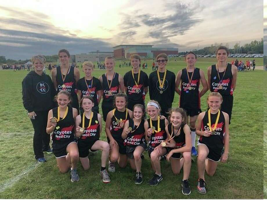 Reed City middle school runners with their medals at Manistee. (Courtesy photo)
