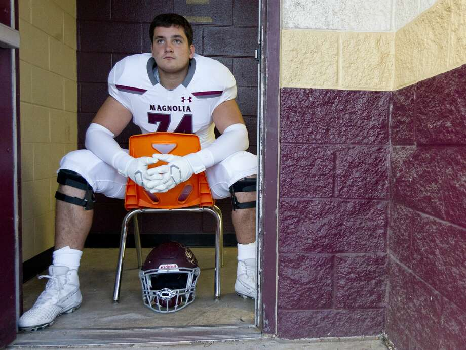 Magnolia offensive lineman Matthew Wykoff (74) watched Magnolia West warm up before a District 8-5A high school football game at Magnolia West High School, Friday, Nov. 1, 2019, in Magnolia. Photo: Jason Fochtman/Staff Photographer