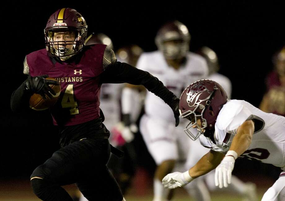 Magnolia West wide receiver Payton Finch (4) runs after making a catch during the first quarter of a District 8-5A high school football game at Magnolia West High School, Friday, Nov. 1, 2019, in Magnolia. Photo: Jason Fochtman/Staff Photographer
