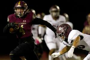Magnolia West wide receiver Payton Finch (4) runs after making a catch during the first quarter of a District 8-5A high school football game at Magnolia West High School, Friday, Nov. 1, 2019, in Magnolia.