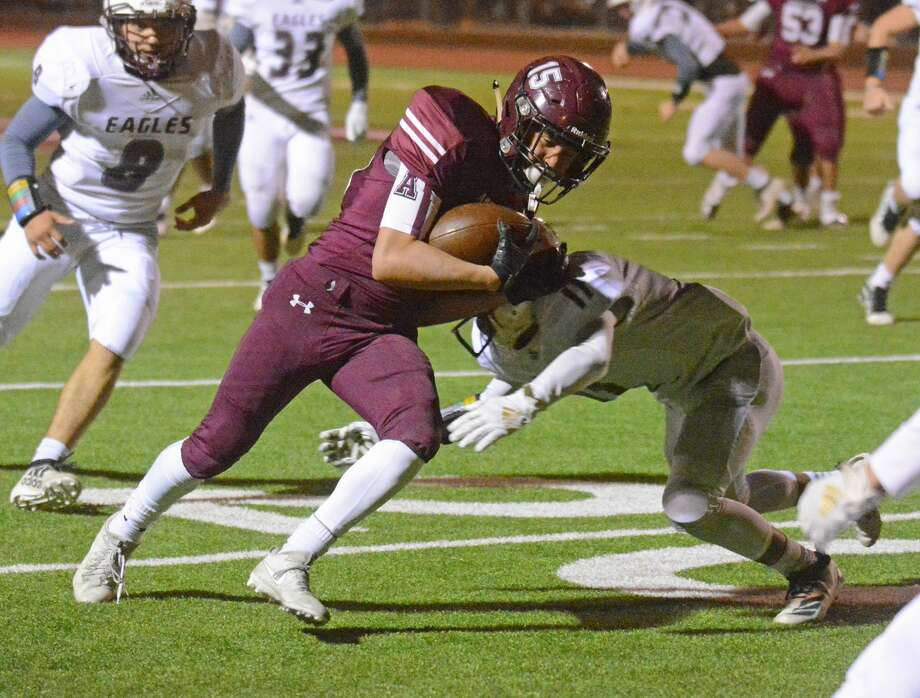 Abernathy's Jaden Zavala attempts to shake off a Lubbock Roosevelt defender after hauling in a catch during their District 2-3A Division II football game on Antelope Field in Abernathy on Friday. Photo: Nathan Giese/Planview Herald