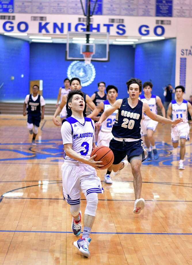 Esteban Pedraza scored 15 points in St. Augustine's win over Houston Second Baptist to open the sixth annual Patrick H. Alexander Jr. Invitational Basketball Showcase Friday. Photo: Cuate Santos /Laredo Morning Times / Laredo Morning Times