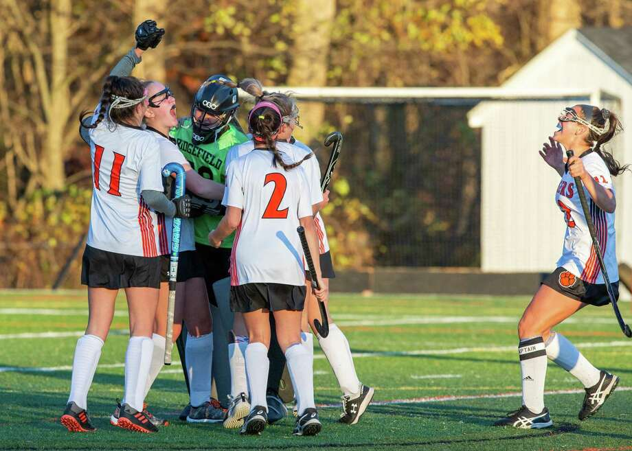 The Ridgefield field hockey team celebrates at the end Friday's 1-0 win over Wilton in the FCIAC quarterfinals. Photo: Gretchen McMahon / For Hearst Connecticut Media