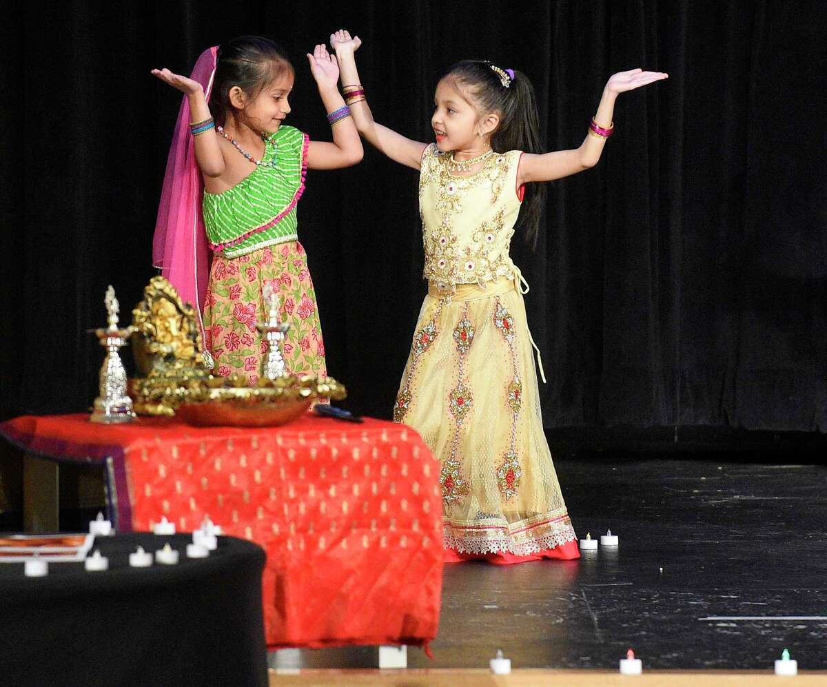 Young performers open with a traditional dance during the 7th Annual Stamford Hindu School Diwali Festival of Lights at the Rogers International School in Stamford, Conn. on Nov. 1, 2019. Hundreds of Fairfield County families gathered to enjoy an evening of food, cultural celebration and special performances by students of the Hindi USA School, a non-profit and volunteer-managed organization, which attempts to instill Indian culture by celebrating heritage and promote the Hindi language with younger kids. Diwali is celebrated to mark different historical events and stories, but they all symbolize the victory of light over darkness, knowledge over ignorance, good over evil, hope over despair.