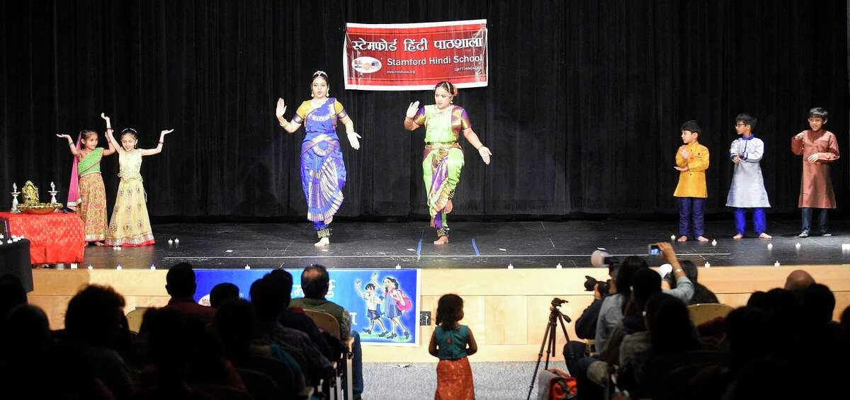Performers open with a traditional dance during the 7th Annual Stamford Hindu School Diwali Festival of Lights at the Rogers International School in Stamford, Conn. on Nov. 1, 2019. Hundreds of Fairfield County families gathered to enjoy an evening of food, cultural celebration and special performances by students of the Hindi USA School, a non-profit and volunteer-managed organization, which attempts to instill Indian culture by celebrating heritage and promote the Hindi language with younger kids. Diwali is celebrated to mark different historical events and stories, but they all symbolize the victory of light over darkness, knowledge over ignorance, good over evil, hope over despair.