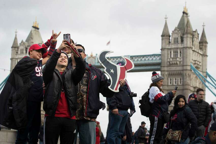 Houston Texans fans gather at More London near the Tower Bridge on Saturday, Nov. 2, 2019, in London. The Texans play the Jacksonville Jaguars at Wembley Stadium on Sunday.