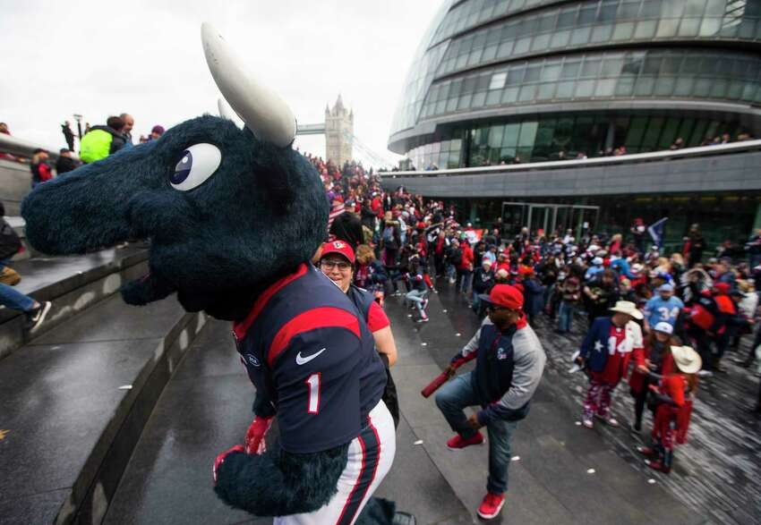 Houston Texans cheerleaders join a group of fans as they gather at More London near the Tower Bridge on Saturday, Nov. 2, 2019, in London. The Texans play the Jacksonville Jaguars at Wembley Stadium on Sunday.