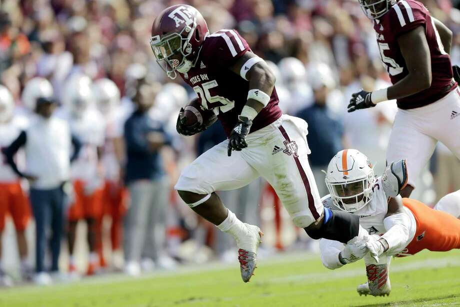 PHOTOS: Texas Bowl Texas A&M running back Cordarrian Richardson (25) breaks free from a tackle from a UTSA defender for a 19 yard touchdown run during the first quarter of an NCAA college football game, Saturday, Nov. 2, 2019, in College Station, Texas. (AP Photo/Sam Craft) >>>Look back at photos from the Aggies' win in the Texas Bowl ... Photo: Sam Craft, Associated Press / Copyright 2019 The Associated Press. All rights reserved.