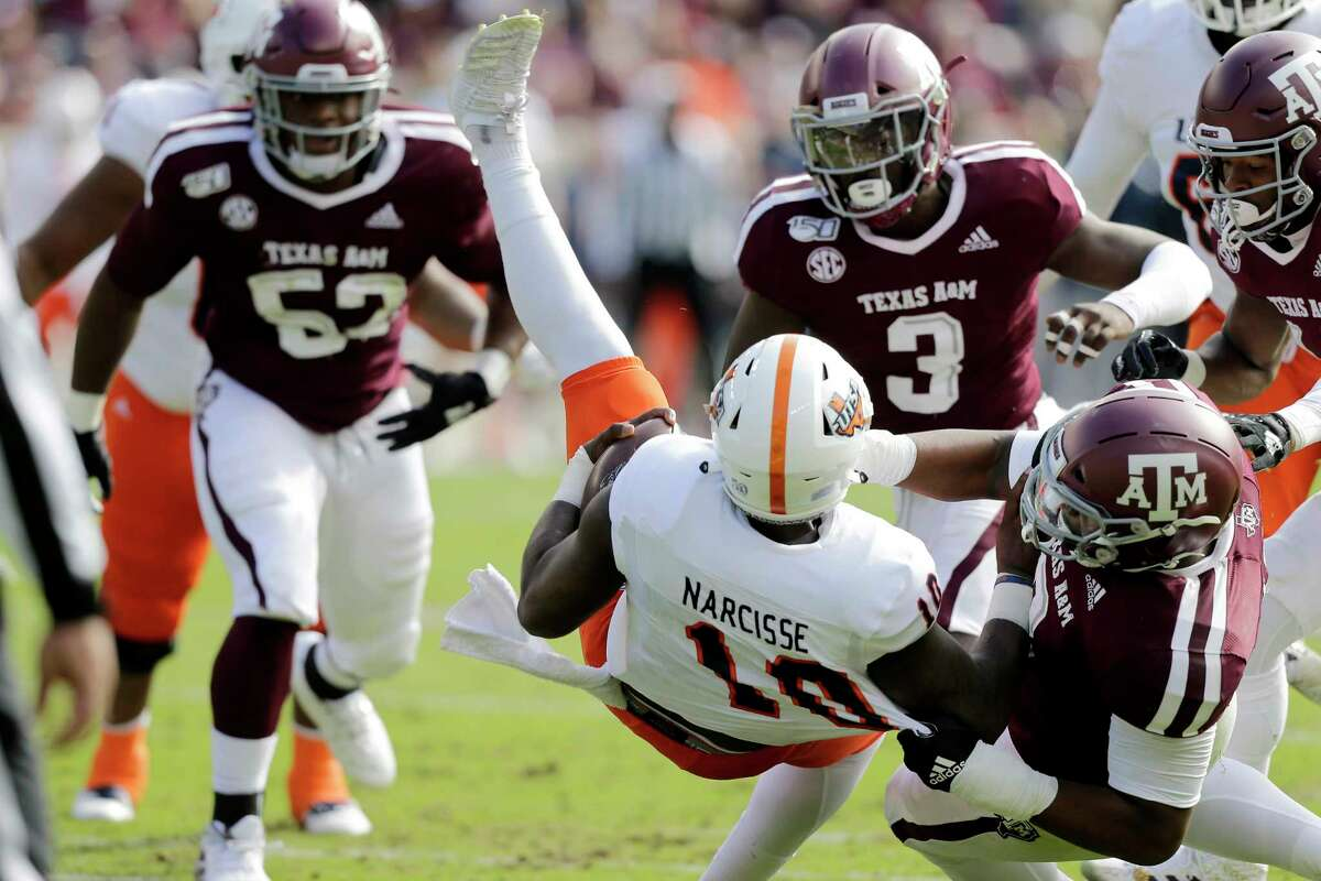 Texas A&M defensive lineman DeMarvin Leal (8) slams UTSA quarterback Lowell Narcisse (10) to the ground for a short loss during the first quarter of an NCAA college football game, Saturday, Nov. 2, 2019, in College Station, Texas. (AP Photo/Sam Craft)