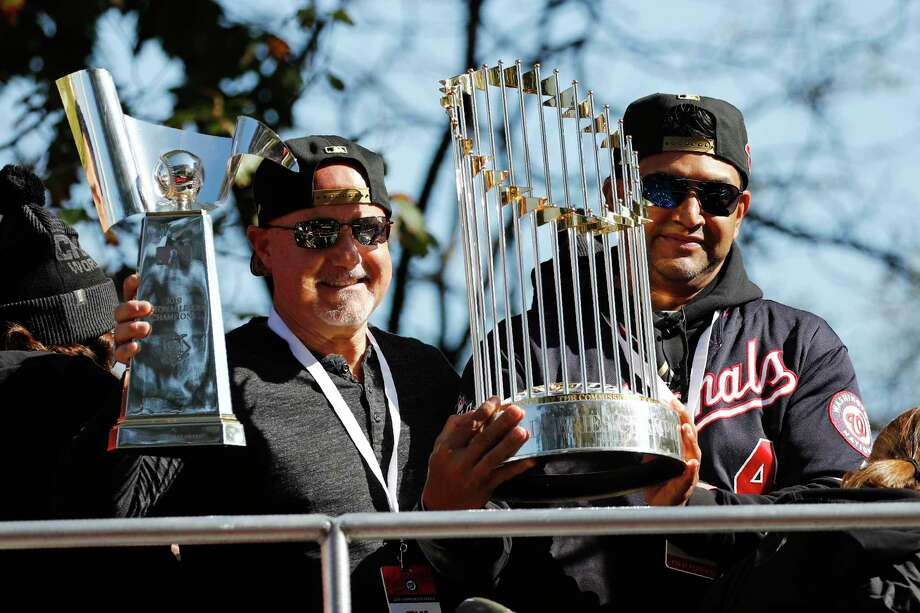Washington Nationals general manager Mike Rizzo, left, and manager Dave Martinez hold up the NLCS trophy, left, and World Series trophy before a parade to celebrate the team's World Series baseball championship over the Houston Astros, Saturday, Nov. 2, 2019, in Washington. Photo: Patrick Semansky, AP / Copyright 2019 The Associated Press. All rights reserved.