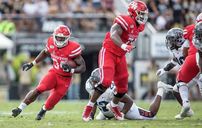 Houston running back Mulbah Car (34) runs through the Central Florida defense during the first half of an NCAA college football game in,Orlando, Fla., Saturday, Nov. 2, 2019. (Photo/Willie J. Allen Jr.)