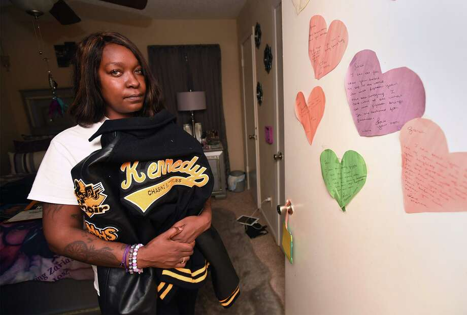 Kandice Kennedy holds Wednesday her daughter Zaria Kennedy's letter jacket. Kandice said her daughter committed suicide in 2018 after several years of being bullied at school. Photo taken Thursday, 10/24/19 Photo: Guiseppe Barranco/The Enterprise, Photo Editor / Guiseppe Barranco ©