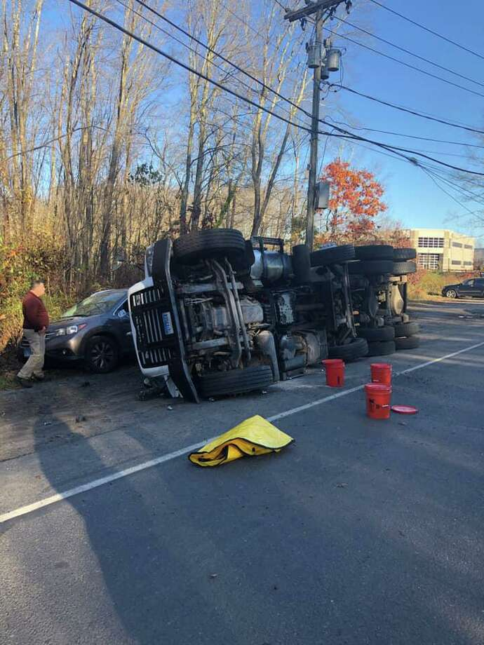 Rollover on Pepper Street in Monroe, Conn., on Friday, Nov. 1, 2019. Photo: Contributed Photo / Stepney Fire Department