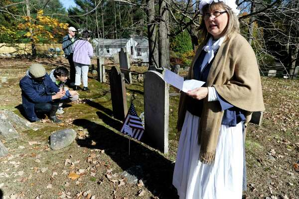 A group of participants gather to listen to Laurie Mapes of Norwalk portrayal of Sarah Betts (1753-1772), who was married to Ezekiel Hawley, as she described her life during the Spirits of the Past cemetery walk and re-enactment at Sharp Hill Cemetery in Wilton, Conn. on Nov. 2, 2019. The event attended by three dozen area residents and sponsored by the Wilton Historical Society and Wilton Congregational Church, Sharp Hill is the oldest surviving cemetery in Wilton, dating back to 1738 when John Marvin gave a small parcel of land to the Congregational Society of Wilton as a site for a meeting house.